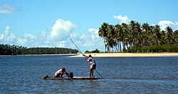 Fishermen at freshwater stream near Tamandaré, PE, Brazil