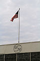 Flag at Wright's Machinery Company Building with logo 2014.jpg