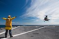 Flickr - Official U.S. Navy Imagery - A Sailor guides a helicopter..jpg