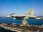Flickr - Official U.S. Navy Imagery - Two F-A-18s fly over USS Enterprise. (1).jpg