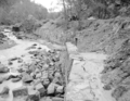 Flood damage to rock wall on Virgin River, a quarter mile south of Court of Patriarchs. Record of damage or defective (52c0ba91389443ad9c0681c13848b18a).tif