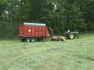 File:Forage harvester - forage wagon 640x480.ogv