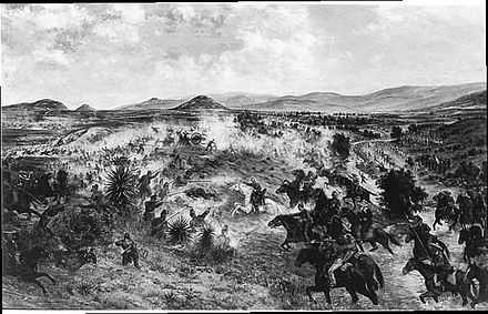 Mexican Imperialists engage Republican forces during the Battle of Miahuatlan in 1866. The battle occurred months after the French announced its withdrawal. Francisco de P. Mendoza, Batalla de Miahuatlan, 1906..jpg