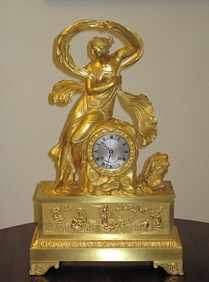 "French Empire mantel clock - An 1822 clock depicting the nereid Galatea, Catherine Palace. The respective allegoric composition in relief of the frieze, represents the ""Triumph of Galatea"", based on the homonymous fresco by Rafael Sanzio."