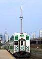 GO Train at Exhibition GO Station with a view of CN Tower.jpg