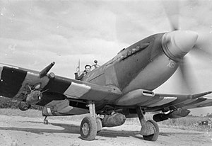 Fighter-bomber - A Supermarine Spitfire Mk. IX in Longues-sur-Mer, Normandy (1944). It carries a 500 lb bomb under the fuselage and a 250 lb bomb under each wing.