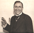 George Calderon smiling with cigarette.png