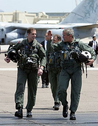 President Bush, with Naval Flight Officer Lieutenant Ryan Philips, after landing on the USS Abraham Lincoln prior to his Mission Accomplished speech, May 1, 2003 George W. Bush walks with Ryan Phillips to Navy One.jpg