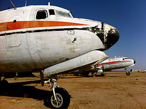 Gila River Memorial Airport - Abandoned Douglas DC-4 airliners, converted to sprayers, at Gila River Memorial Airport