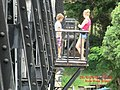 Girls Leaning out on the Safety Platforms of the Kwai River Bridge - panoramio.jpg