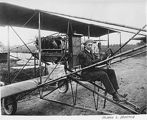 Glenn L. Martin - Glenn Martin in a pusher-biplane, circa 1912 (note the newspapers stacked on the wing; Martin delivered newspapers as a part of his promotional efforts to fund his first plant)