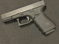 Glock 19 Gen 4 pistol black background.png
