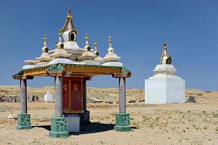 Prayer wheel and stupas. Khamar Monastery. Gobi Desert, Dornogovi Province, Mongolia.