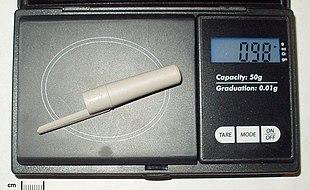BIC pen cap, about 1 gram.
