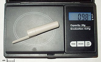 Gram - Image: Gram (pen cap on scale)