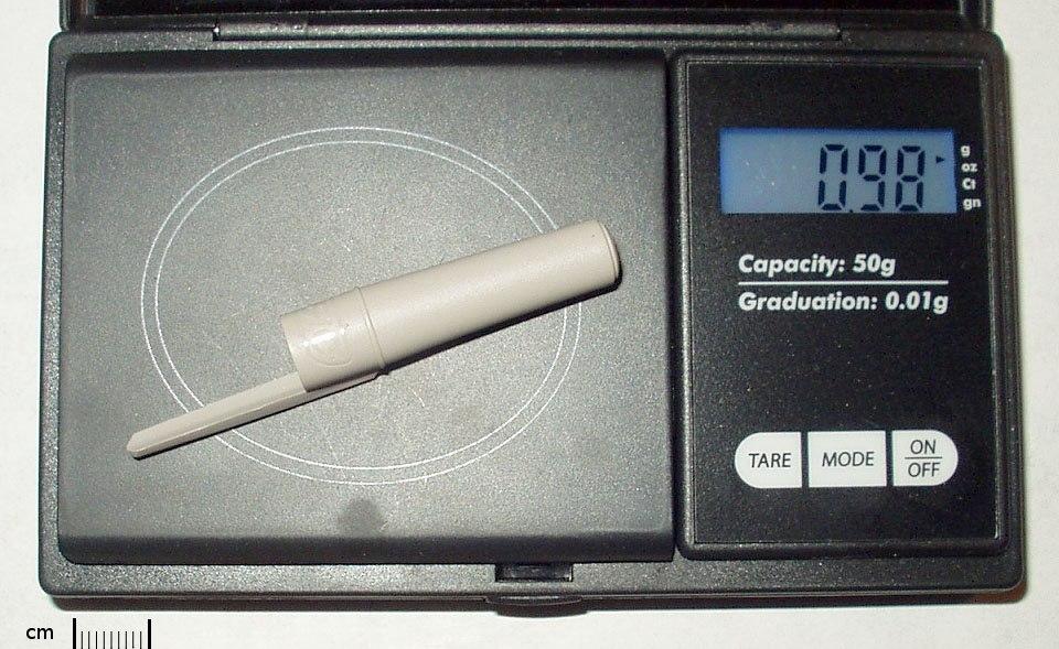 Gram (pen cap on scale)
