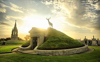 Greenwood Cemetery, New Orleans - Front of Greenwood Cemetery with Fireman and Elks tomb monuments in sunset