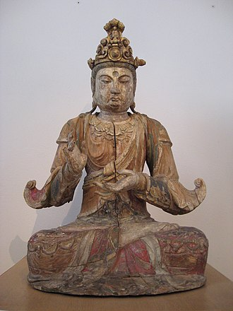 Guanyin - Guanyin, sitting in the lotus position, the damaged hands probably performing dharmacakramudra, a gesture that signifies the moment when Buddha put the wheel of learning in motion; painted and gilded wood, China, Song/Jin period, late 13th century