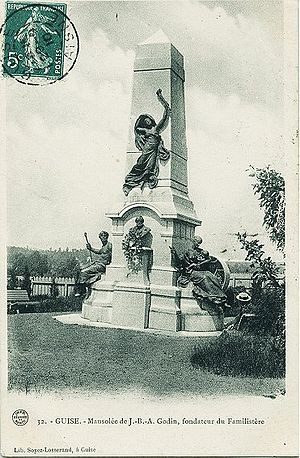 """Amédée Donatien Doublemard - Old postcard showing monument over Godin tomb. Shows the bust of Godin and the two seated figures """"Le travail"""" and """"La Famille"""" and above the bust the composition L'Immortalité"""