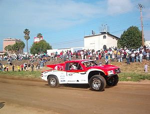 Gus Vildósola - Gus Vildósola driving his Trophy Truck during the 2005 Baja 500