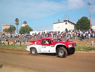 Gus Vildósola - Gus Vildósola driving his Trophy Truck during the 2005 Baja 500