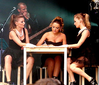 Hadise - Hadise (center) performing an autobiographical song during a concert in Mechelen, August 2009