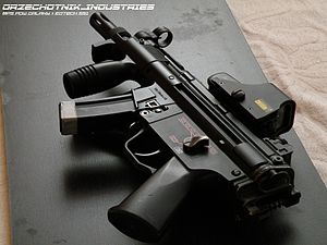 Holographic weapon sight - Holographic weapon sight on an airsoft replica of a Heckler & Koch MP5K-PDW.