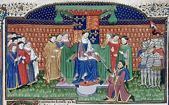 """John Stafford (bishop) - Henry VI enthroned. The leading figure at far left holding a mace/staff/baton with a purse (containing the Great Seal) attached to his waist appears to be the Lord Chancellor, those items being the symbols of his office. Possibly John Stafford (d.1452), Lord Chancellor (1432-1450) and Archbishop of Canterbury (1443-1452). Detail from """"Talbot Shrewsbury Book"""", 1444-45"""