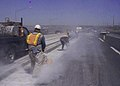 Highway road workers use high power saws (9245786301).jpg