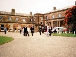 Hillsborough Castle - Guests leaving Hillsborough Castle to walk through its grounds.