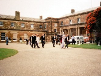 Hillsborough Castle - Guests leaving Hillsborough Castle to walk through its grounds.