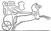Carro de combate hitita. El artista egipcio —que obviamente no ha estado en combate— ha representado el eje en la posición que ocupaba en los carros egipcios. En los hititas se ubicaba más adelante.
