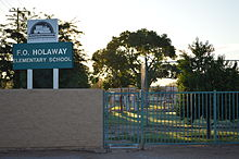 F.O. Holaway Elementary School front sign and part of playground