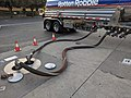 Hoses used to refill underground tanks at Rotten Robbie.jpg