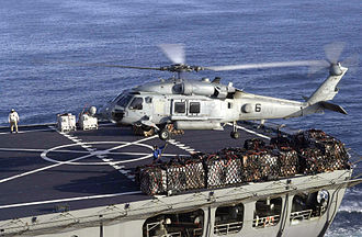 Underway replenishment - A SH-60 Sea Hawk transferring stores between ships, 2003.