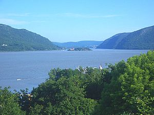 Hudson Highlands - Wind Gate, the northern entrance to the Hudson Highlands, as seen from Newburgh. Breakneck Ridge is to the left, Storm King Mountain to the right with Bannerman's Island in the middle of the river and West Point visible in the distance