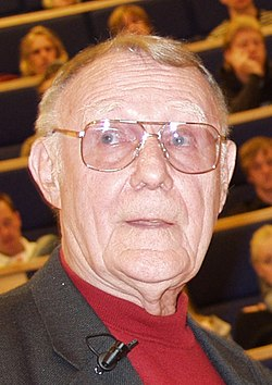Ingvar Kamprad, the founder of IKEA, lecturing a group of students at Växjö University in Sweden