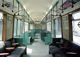 London Underground R Stock - Inside an R stock driving motor (DM). These had four small windows in the central saloon between the double doors, and two sets of transverse seats in the centre bay.