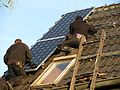 Installation of photovoltaic modules on roof.jpg
