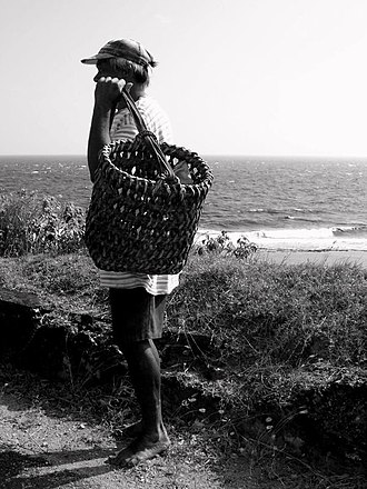 Batanes - An Ivatan holding one of many types of traditional Ivatan baskets.