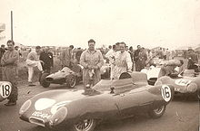 J Crosthwaite (with oily rag) and Graham Hill (on left of picture) with Lotus.jpg