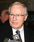 Jim Bolger at press conference retouched.jpg