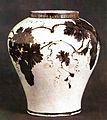 Joseon white porcelain jar with underglaze iron grape design.jpg