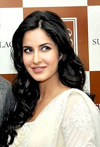 Katrina smiling and looking away from the camera