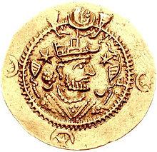 Côté face d'une pièce de monnaie représentant un homme à la tête couronnée
