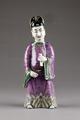 Kinesisk figur hållande kastanjetter från 1800- eller 1900-talet - Hallwylska museet - 95976.tif