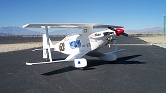 "Radio-controlled aircraft - This Kyosho ""Phantom 70"" biplane is a semi-scale replica of a class winner and record holder from the 2007 Reno Air Races.  In this example, the fuselage with its complex curves as well as the engine cowl, wheel pants and wing struts are rendered in fiberglass.  The wings and horizontal stabilizer are traditional balsa/plywood construction"