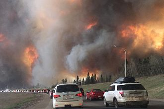 2016 Fort McMurray Wildfire - Fort McMurray residents evacuating along Highway 63 as the fire encroaches on the area
