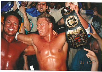 Rob Conway - Conway (left) with Sylvain Grenier celebrating with the World Tag Team Championship