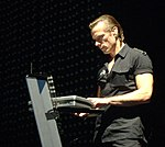 Larry Mullen playing keyboards.